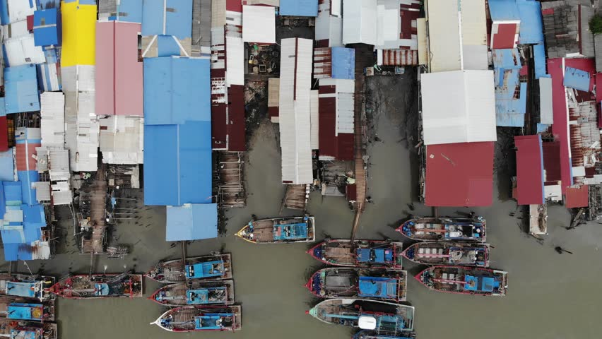 Aerial view of the fisherman village with wooden fish boat.Motion with moving up. | Shutterstock HD Video #1028536676