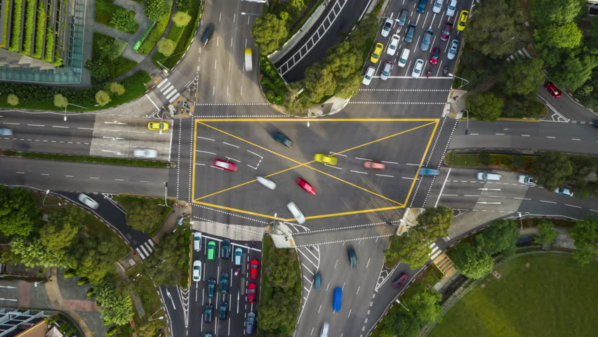 sunny day singapore city traffic street crossroad aerial topdown panorama 4k timelapse Royalty-Free Stock Footage #1028547806