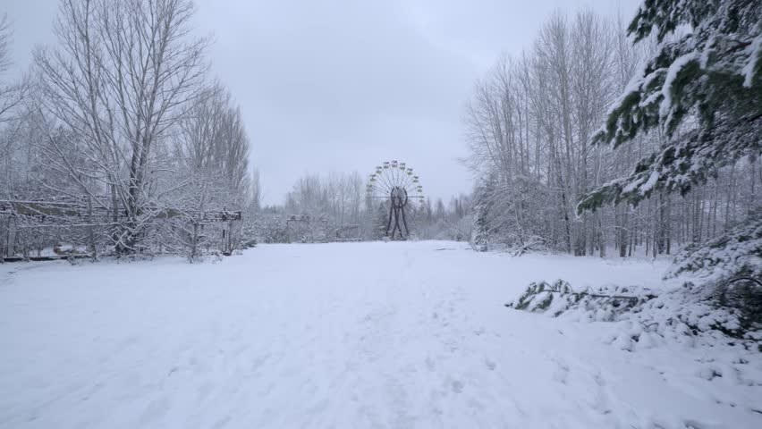 Dolly Shot of Famous Pripyat Ferris Wheel During the Winter   Shutterstock HD Video #1028554790