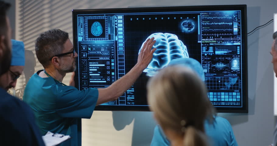 Medium shot of a doctors discussing brain damage diagnosis at a digital screen with a 3D image of a brain | Shutterstock HD Video #1028557433