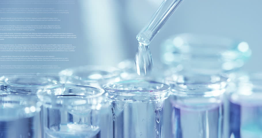 in a laboratory a scientist with a pipette analyzes a colored liquid to extract the dna and molecules in the test tubes concept research biochemistry nature pharmaceutical medicine #1028557889