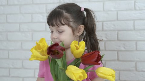Cute little girl with flowers.