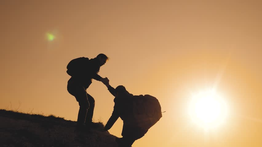Teamwork help business travel silhouette concept. group of tourists lends a helping hand climb the cliffs mountains. people climbers climb to the top overcoming hardships the path to victory lifestyle   Shutterstock HD Video #1028575733