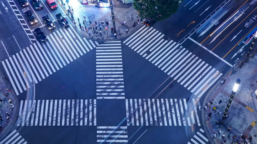 Tokyo's scrambled intersection twilight timelapse #1028578766