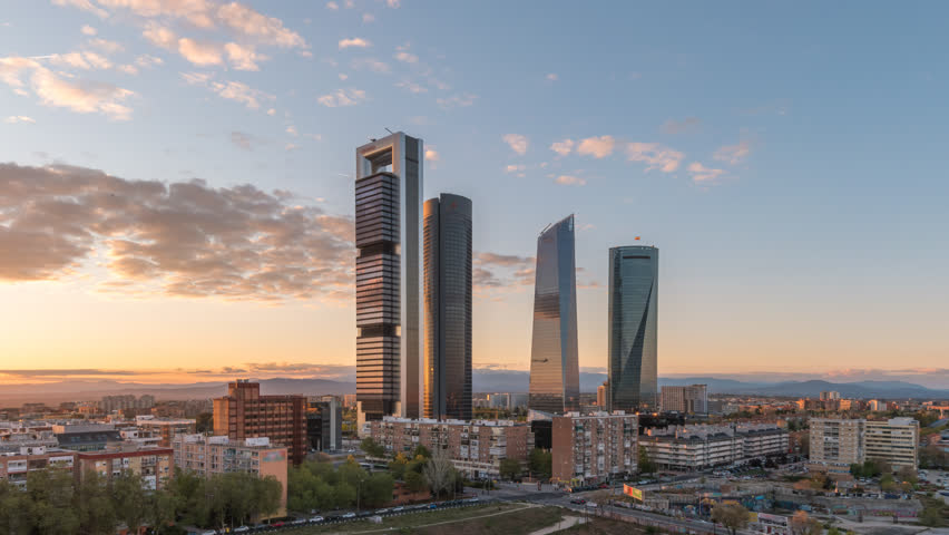 Madrid Spain time lapse 4K, city skyline day to night sunset timelapse at financial district four towers Royalty-Free Stock Footage #1028580827