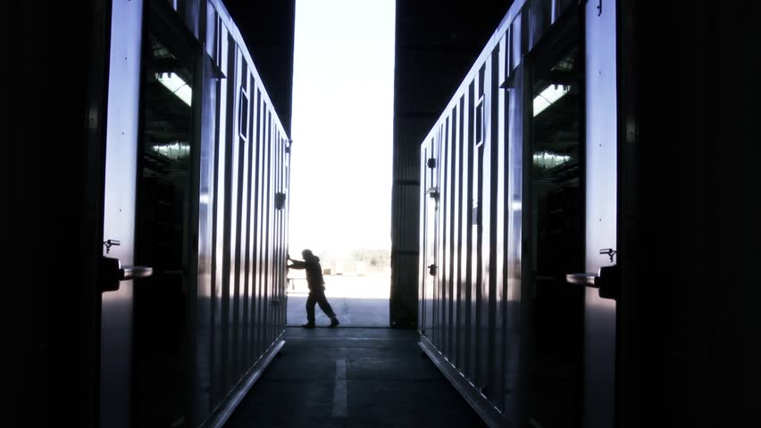 Man Pushing Hangar Metallic Door.  | Shutterstock HD Video #1028582027
