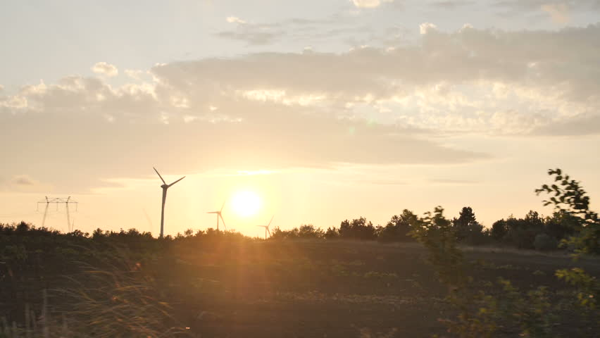 4K Shoot Of Wind Mills at sunset | Shutterstock HD Video #1028583299
