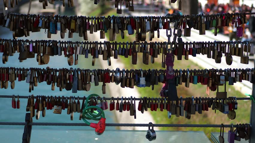 Padlocks hanging on the bridge. | Shutterstock HD Video #1028587904