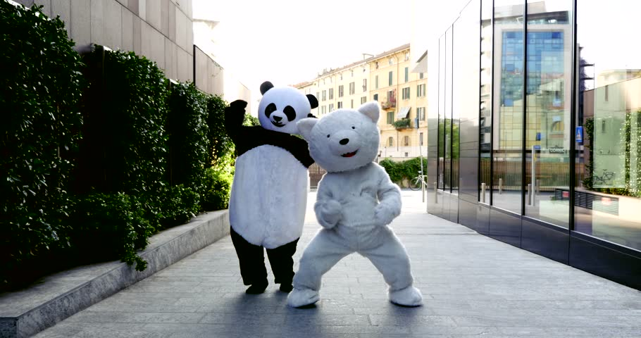 Panda and polar bear dancing in the city to demonstrate and protest against world pollution and animal rights