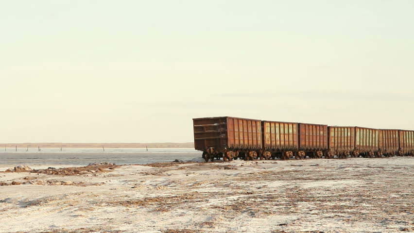Old rusty train wagons with stalactites of salt at the lake  | Shutterstock HD Video #1028599574