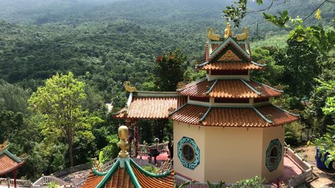 Chinese temple on the tropical island of Kho Phangan. Chinese-style buildings in the middle of the rainforest. Kho Phangan, Thailand, 18.04.2019