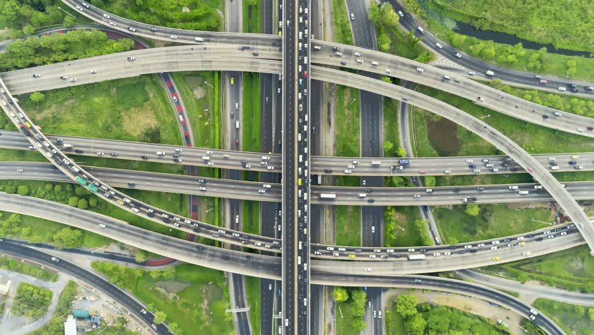 Timelapse of night city traffic on 4-way stop street intersection circle roundabout in bangkok at day, thailand. 4K UHD horizontal aerial view. | Shutterstock HD Video #1028606468