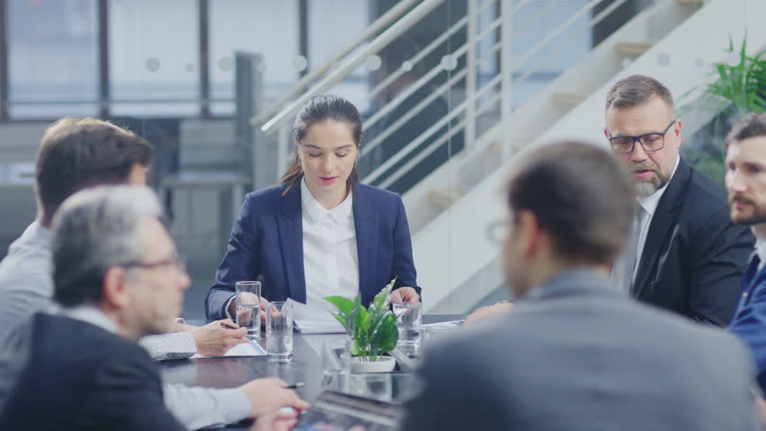 Corporate Meeting Room: Confident Female Executive Director Makes a Report to a Members of the Board and Investors about Company's Achievement of Record Breaking Annual Revenue Results