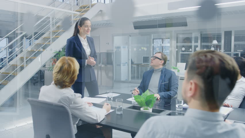 Corporate Meeting Room: Young and Ambitious Female Executive Director Delivers Powerful Speech About Company's Achievement of Record-Breaking Annual Revenue Results to a Board of Executives, Investors