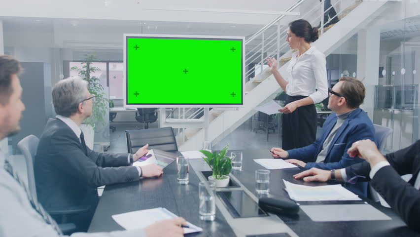 In the Corporate Meeting Room: Female Executive Uses Digital Chroma Key Interactive Whiteboard for Presentation to a Board of Directors, Lawyers, Investors they Applaud. Green Mock-up Screen Royalty-Free Stock Footage #1028612348