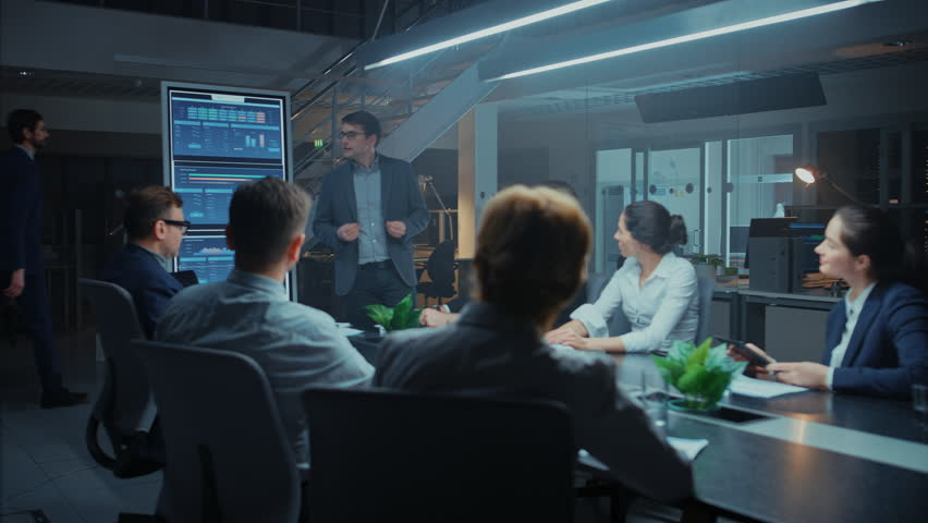 In the Corporate Meeting Room: Energetic and Confident Young Startup Creator Uses Digital Interactive Whiteboard for Presentation and Delivers Powerful Speech to a Board of Executives Investors Royalty-Free Stock Footage #1028612465