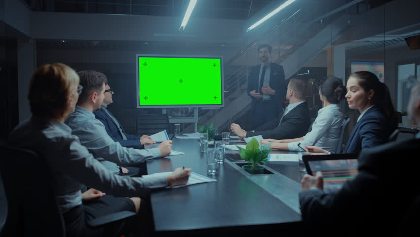 Late at Night In the Corporate Meeting Room: Director Talks and Uses Digital Chroma Key Interactive Whiteboard for Presentation to Executives, Investors. Green Mock-up Screen in Horizontal Mode | Shutterstock HD Video #1028612486