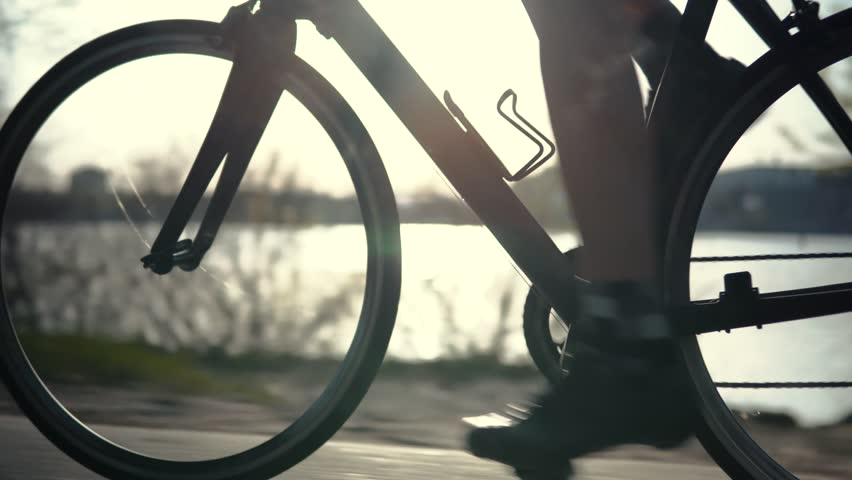 Cyclist Training Leisure Twists Pedals On Triathlon Bicycle.Gear System  And Bike Wheel.Cycling Gear Athlete Workout.Sport Healthy Lifestyle Fitness Vacation.Cyclist Pedaling Bike Endurance Exercising Royalty-Free Stock Footage #1028623430