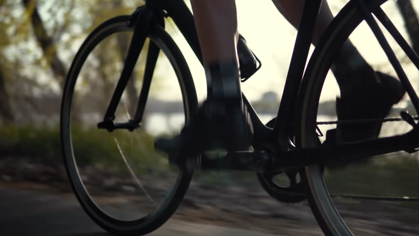Cyclist On Bike Pedaling Recreation Fitness Sport At Sunset.Gear System Bicycle And Bike Wheel Cycling Rotation.Cyclist Twists Pedals And Riding Triathlon Road Bike.Cycling Gear Athlete Workout Royalty-Free Stock Footage #1028623436