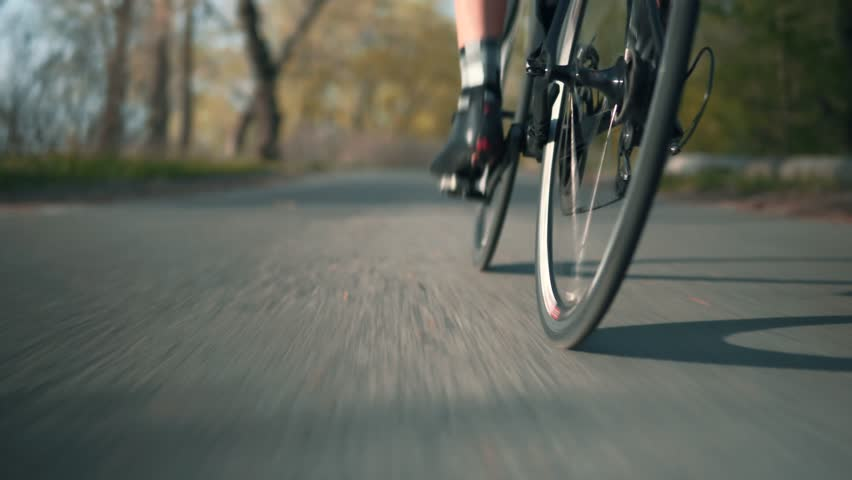 Bicycle Wheel And Bike Gear In Motion.Sport Cycling Cardio Workout Exercising.Bike Wheel Rotate.Cycling Gear And Tyre.Cyclist Fitness Activity Road Bicycle.Sport Recreaton Training Fitness Workout. Royalty-Free Stock Footage #1028623487