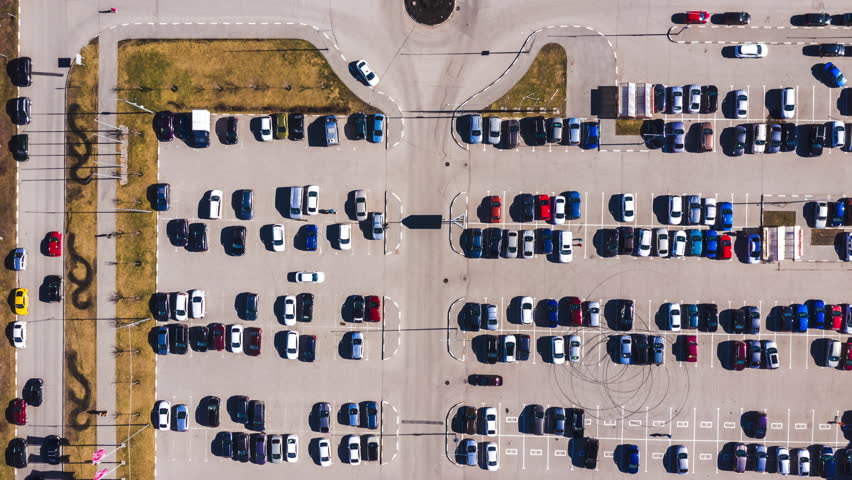 Aerial top-down view of parking lot near city mall.   Shutterstock HD Video #1028630807