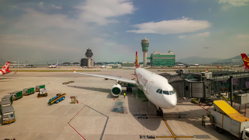 SHENZHEN, CHINA - OCTOBER 3 2018:  sunny day shenzhen city airport window aircraft ready to fly panorama 4k timelapse circa october 3 2018 shenzhen, china.