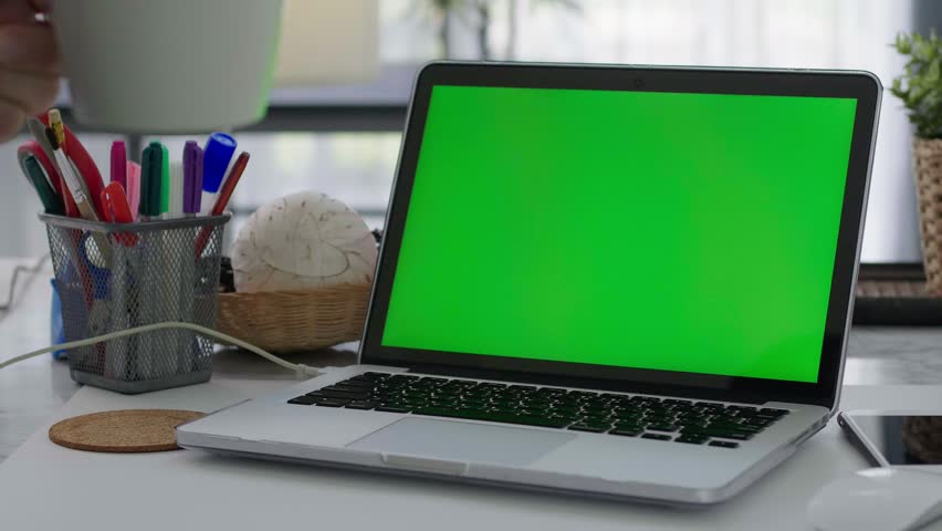 Desk working at home on with laptop green screen   Shutterstock HD Video #1028646638