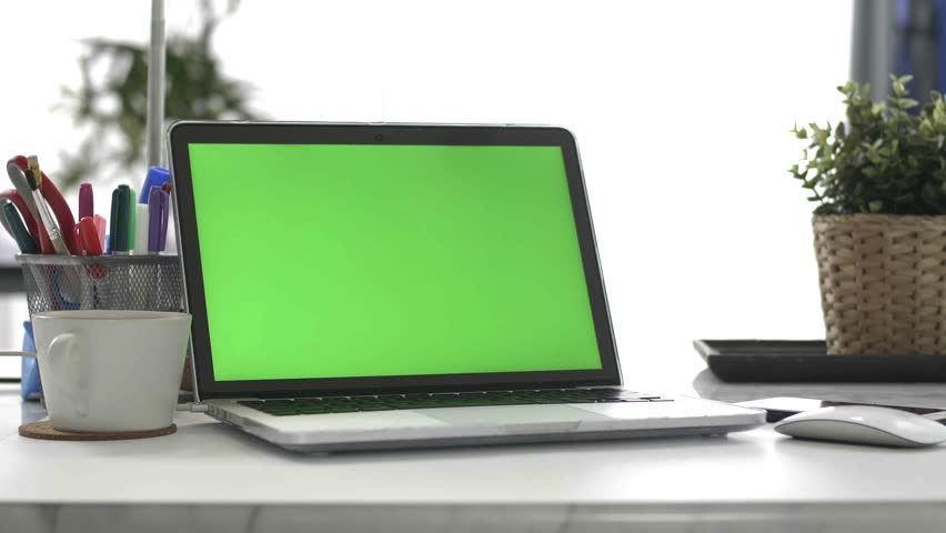 Desk working at home on with laptop green screen   Shutterstock HD Video #1028646641