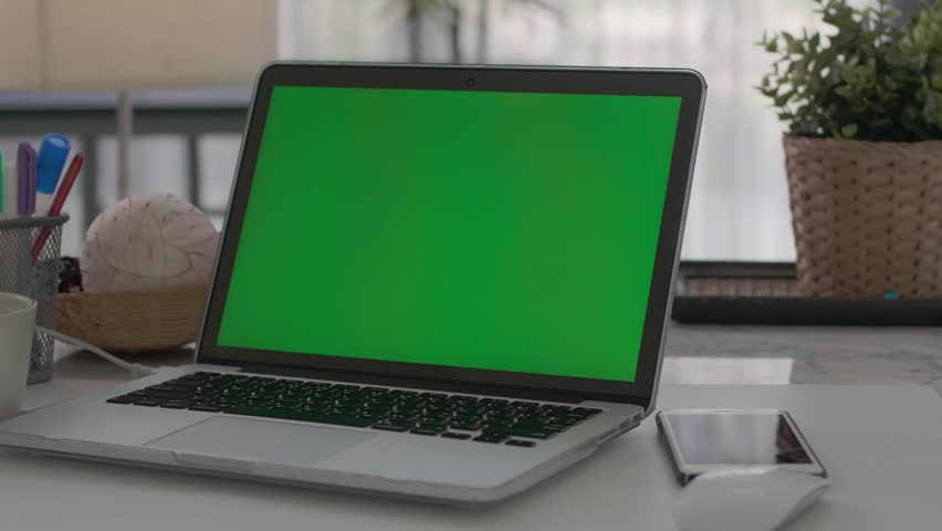 Desk working at home on with laptop green screen   Shutterstock HD Video #1028646644