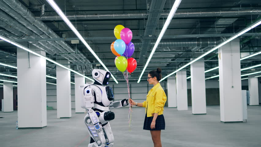 Spacious hall with a cyborg getting balloons from a girl | Shutterstock HD Video #1028673194