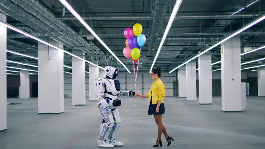 Young lady is giving balloons to a human-like cyborg | Shutterstock HD Video #1028673260