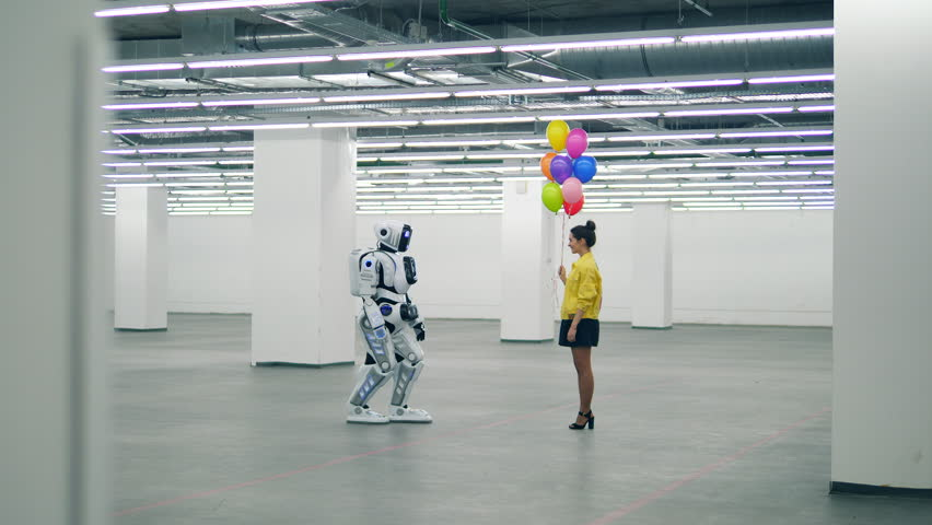 Massive hall with a robot getting balloons from a lady | Shutterstock HD Video #1028673284