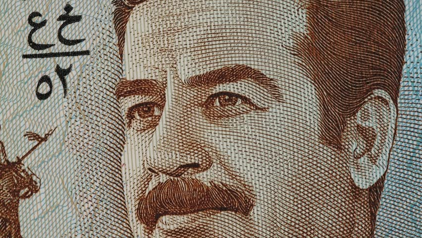 Saddam Hussein on Iraq dinar note macro rotating. Stock video footage