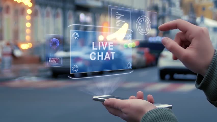 Female hands on the street interact with a HUD hologram with text Live chat. Woman uses the holographic technology of the future in the smartphone screen on the background of the evening city   Shutterstock HD Video #1028681609
