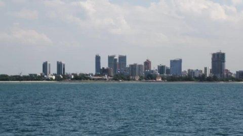 Dar es salaam / Tanzania - April 28th 2019: Approaching by ferry boat from Zanzibar to Dar es salaam city, Tanzania.