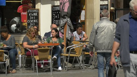 Belgium, Brussels - October, 2016: People relaxing at the outdoor tables of a restaurant