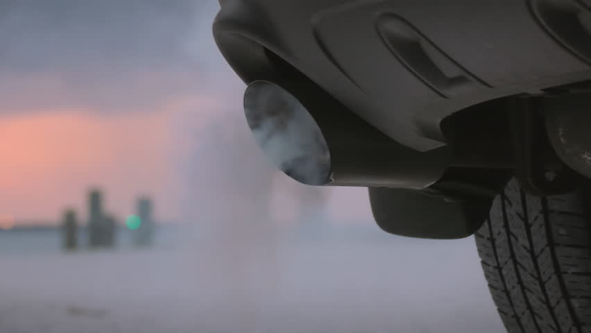 Smoke emissions fumes from car exhaust tailpipe causing air pollution and smog Royalty-Free Stock Footage #1028733545