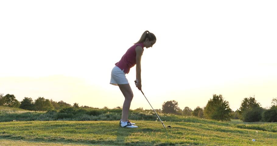 Ludwigshafen am Rhein, Rheinland-Pfalz / Germany - 05 01 2019: Young Adult Girl Playing Golf at Sunset Beautiful Golf Course