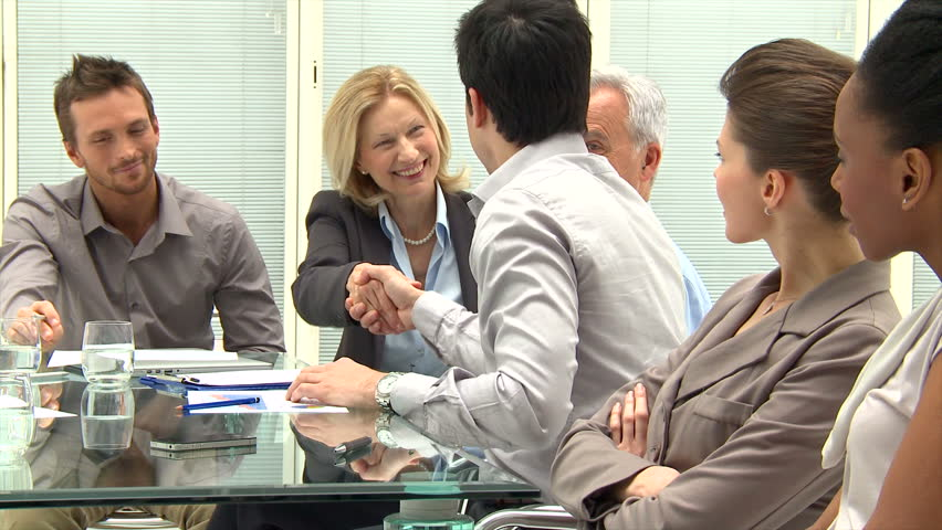 Successful Business Executives Shaking Hands With Each Other.  Business people shaking hands after the meeting. Business handshake between collaborators in the modern office. Royalty-Free Stock Footage #10287644