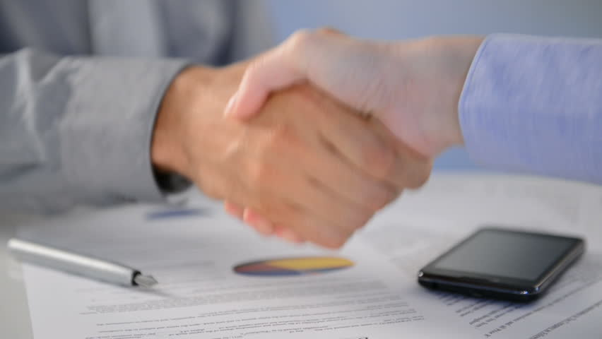Close Up Of Businesspeople Shaking Hands At Desk.  Close up of business executives shaking hands in an office. Business associates shaking hands in office. Business deal. #10287668