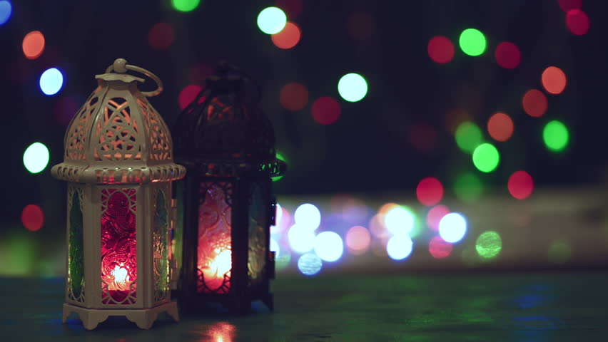 Low light studio set up shot of lighted lantern - showing ramadan kareem or eid mubarak celebration conceptual. | Shutterstock HD Video #1028768129