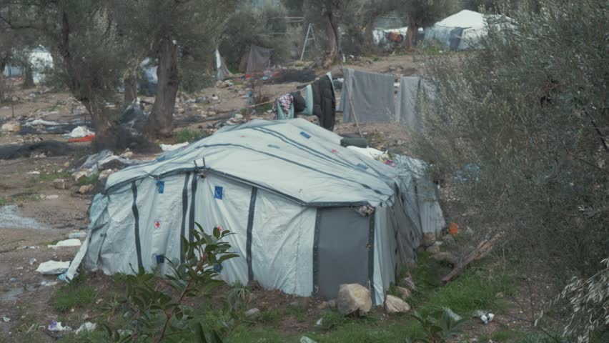 Establishing Shot of Tents and Clothes Lines at a Refugee Camp in Greece.
