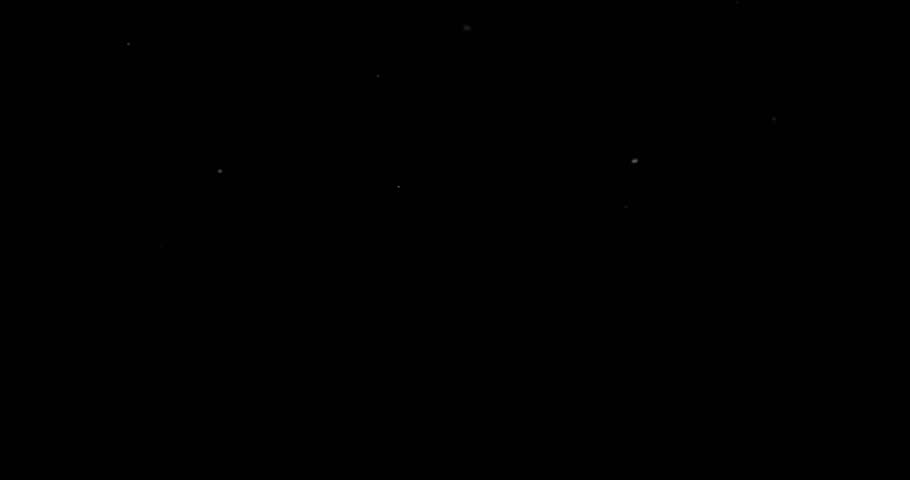 Flying dust particles on a black background | Shutterstock HD Video #1028813948