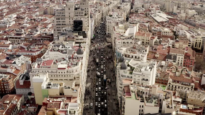 Long aerial shot of the city center Madrid. The Gran via on a busy day with citylife on the streets. People and cars are roaming around in the capital of Spain. | Shutterstock HD Video #1028815169