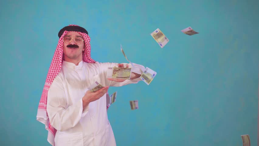 cheerful Arab man with a mustache and traditional clothes with Audi ,throws money