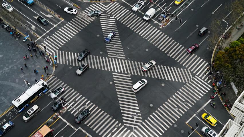 Blur motioin concept.Aerial view car move fast  on pedestrian crosswalk in modern city #1028859443