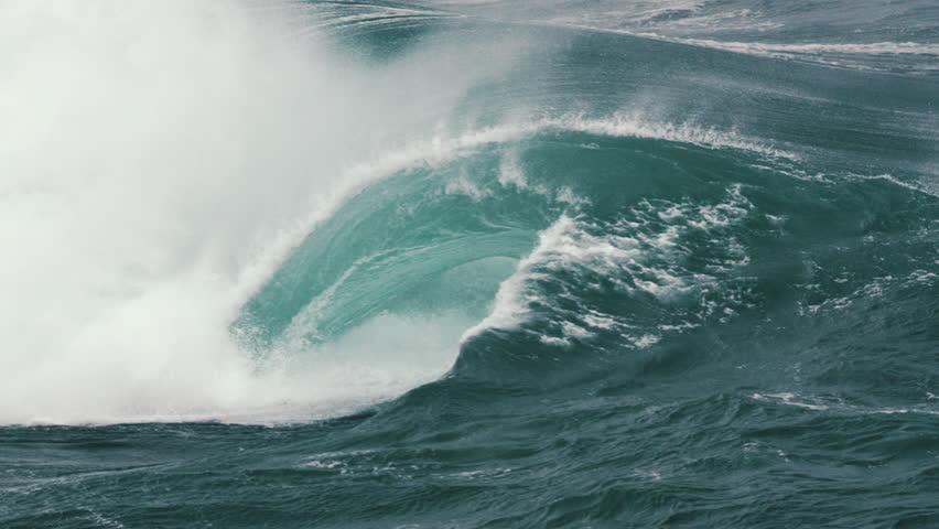 Large wave breaking in slow motion. | Shutterstock HD Video #1028860154