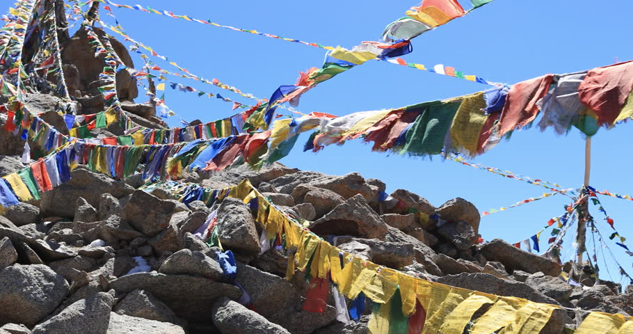 Himalaya mountains background with Buddhist prayer flags slow motion video. North India travel landscape   Shutterstock HD Video #1028872634