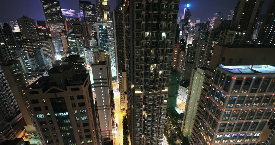Office building windows and high city towers in Hong Kong town centre at night | Shutterstock HD Video #1028875010
