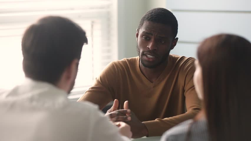 Confident african businessman manager consulting handshaking clients make insurance mortgage deal at business meeting, black applicant talking to hr shake hand of recruiter get hired at job interview Royalty-Free Stock Footage #1028899988